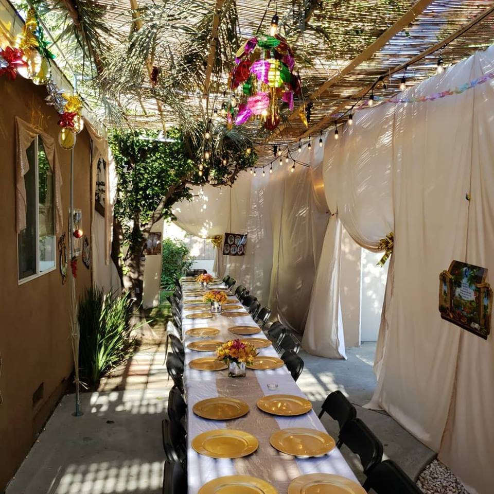 Sukkot at The Malul's, Sukkah and Table - AishLIT Website 1