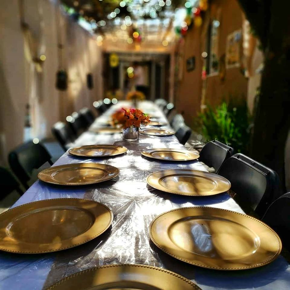 Sukkot at The Malul's, Sukkah and Table - AishLIT Website 2