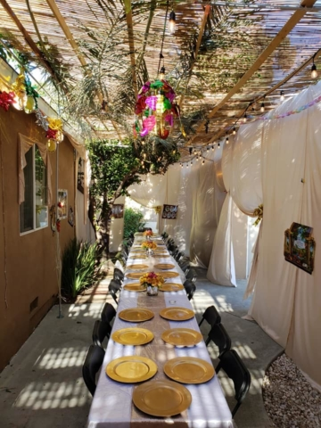 Sukkot at The Malul's, Sukkah and Table - AishLIT Website 5